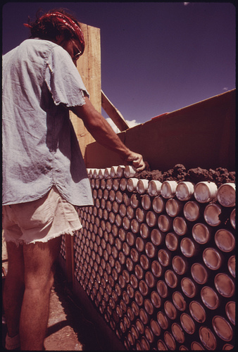 Construction of One of Three Experimental Houses Built from Empty Beer and Soft Drink Cans.
