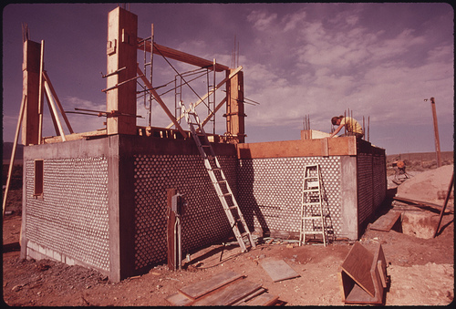 Exterior of an Experimental All Aluminum Beer and Soft Drink Can House Under Construction near Taos, New Mexico.