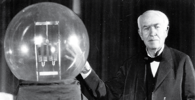 Thomas Edison shows off a big-ass light bulb.