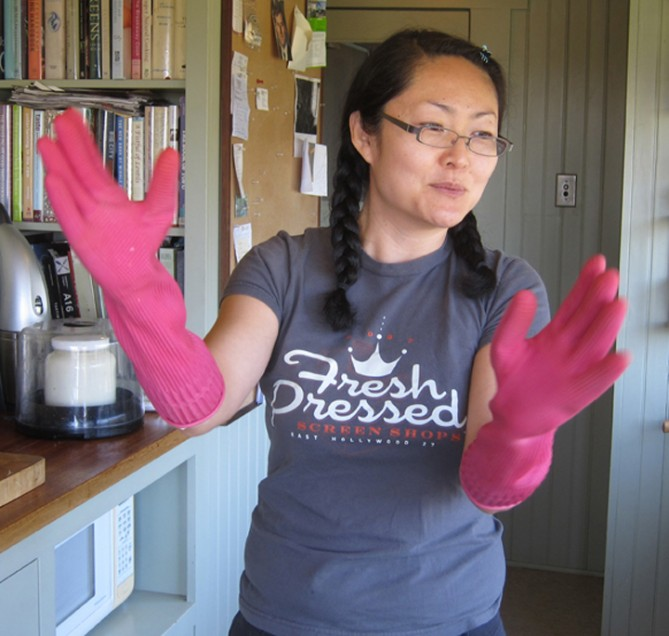 Hae Jung showing off her special kimchi gloves.