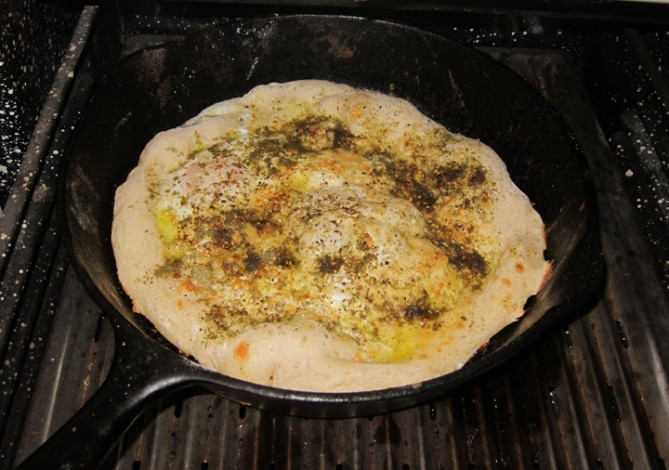 Breakfast pizza with eggs and zaatar.