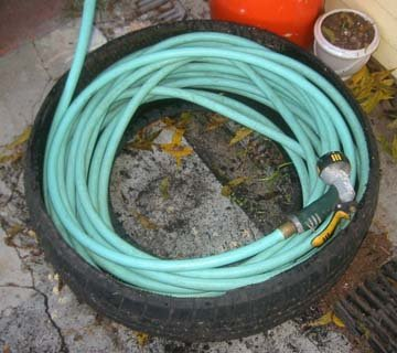 A Used Tire Hose Caddy Root Simple