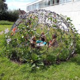 A trellis made out of bicycle wheels.