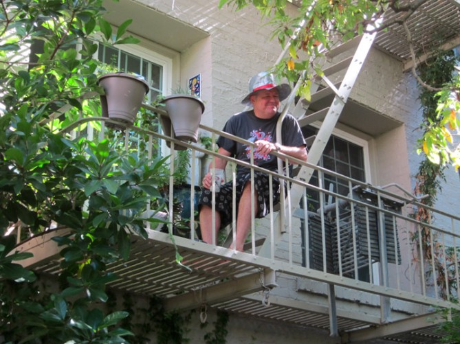 TK looking down on the garden from the balcony of his apartment.