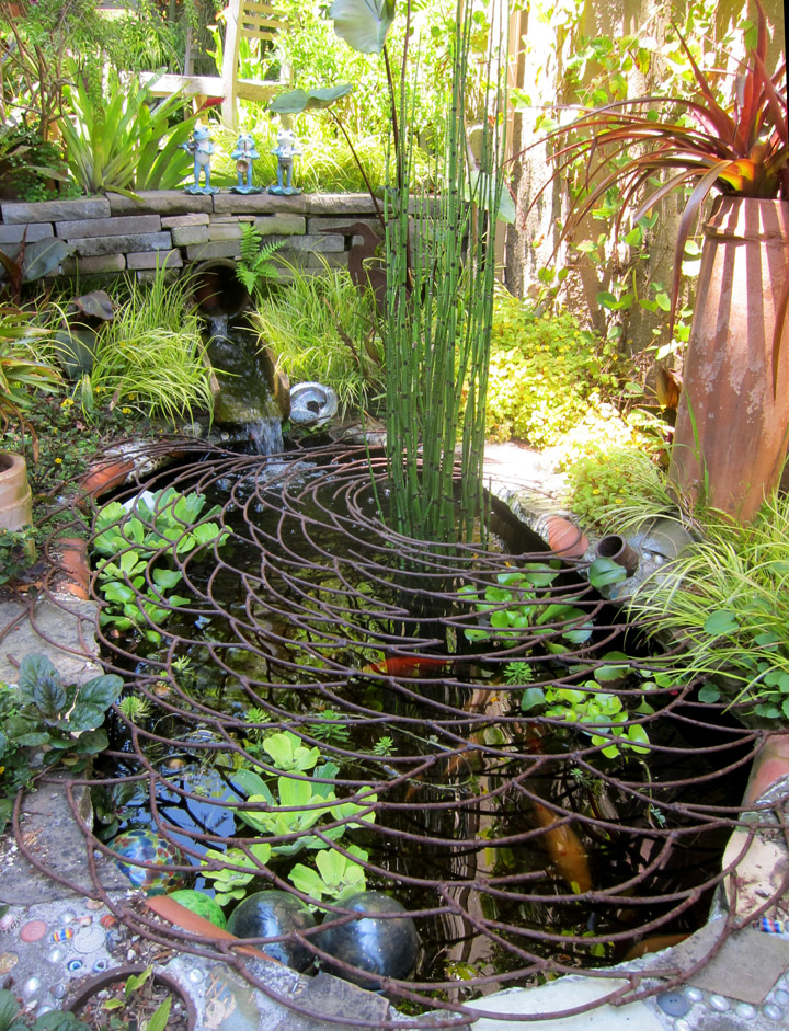 Picture sundays world s most beautiful raccoon proofing for Large outdoor fish ponds