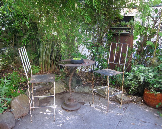 One of many inviting seating areas in the Organic Mechanic's garden.