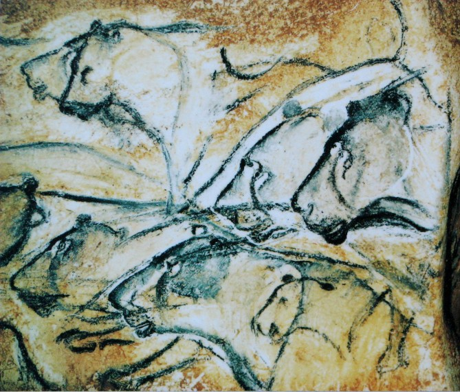 cave painting of lion heads